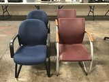 Two burgundy lobby chairs with two blu3 lobby chairs