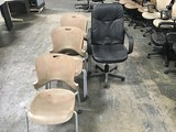 Black office chair with seven brown lobby chairs