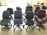 Eight assorted office chairs