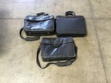 Three black laptop cases