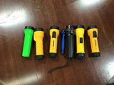 Seven assorted flashlights