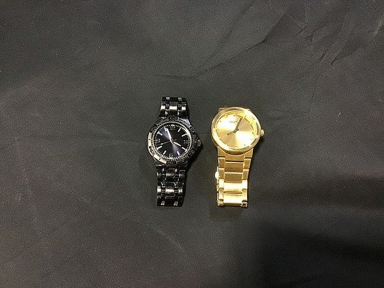 Nixon gold colored watch with black watch