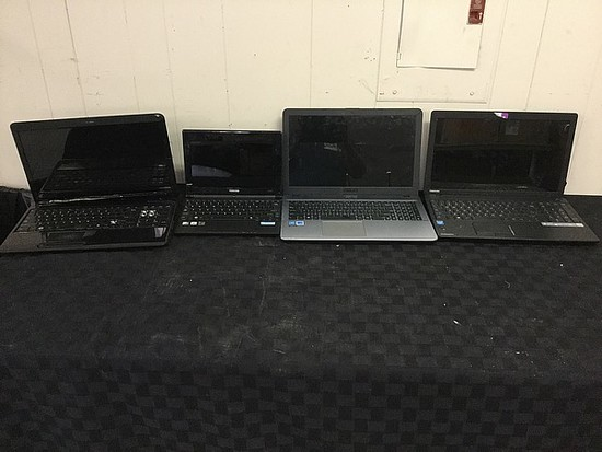4 laptops,Toshiba, ASUS Possibly Locked No chargers, some damage