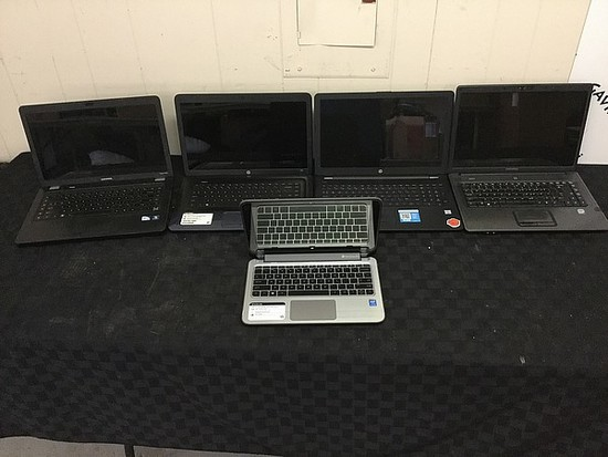 5 laptops,COMPAQ, HP, possibly locked No chargers, some scratches