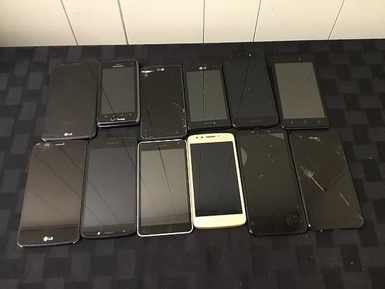 12 cellphones, possibly locked, some damage LG, MOTOROLA, ZTE