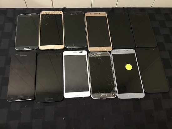 12 Samsung cell phones, possibly locked, some damage