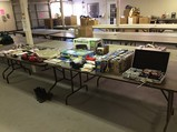 Books, boxing gloves, food saver, label maker, chips, stake board Camera,