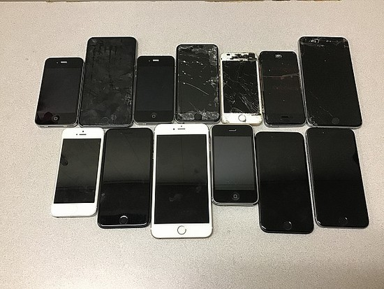 Cellphones, possibly locked, some damage, Unknown activation status iPhones