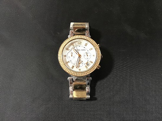 Silver/gold colored Michael Kors watch