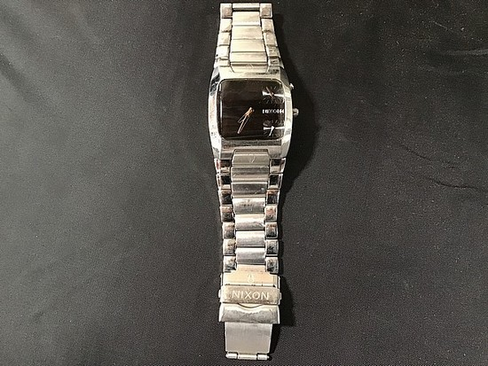 Nixon black and silver watch