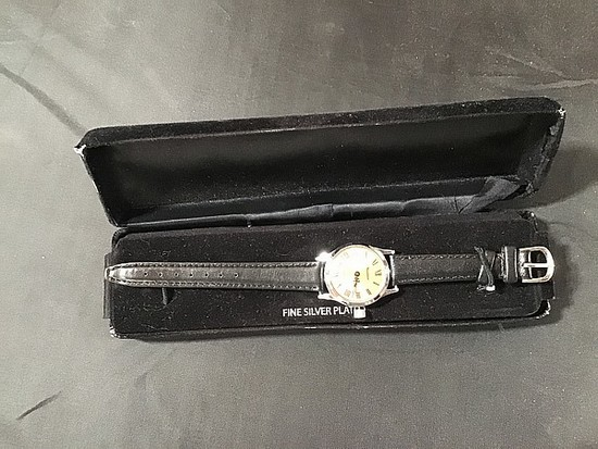 Black watch with velvet case