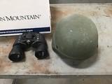 Green helmet with pair of binoculars