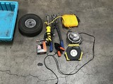 Yellow rope, mini fan, bolt cutters, tire Two work lights, box of screws