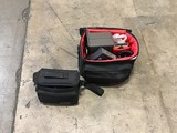 Two camera bags with camera parts