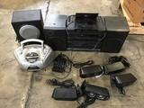 5 small speakers, black radio, grey radio,