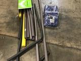 2 Ozark Trail 9x12ft blue tarps, box of installation tubes