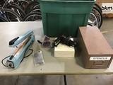 Green box with impulse sealer, metal box with metal letter stencils Bag sealer