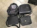 Three black laptop bags with black backpack