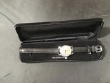 Black watch with velvet case