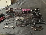 Assorted eye glasses and sunglasses
