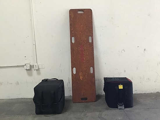 Wood medical stretcher with two black bags