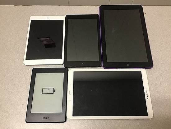 Tablets possibly locked, some damage, no chargers iPad, amazon, Samsung
