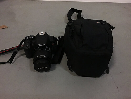 Canon EOS rebel T4i camera with bag (Used ) NOTE: This unit is being sold AS IS/WHERE IS via Timed A