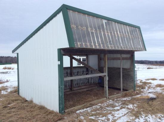 11' x 16' portable calf feeding shed w/ 10-head locks & feed alley.