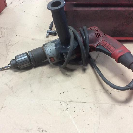 "Milwaukee 1/2"" magnum hammer drill w/ tool box."