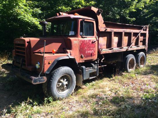 1976 Mack DM 607S tandem axle dump truck; s/n 4564.