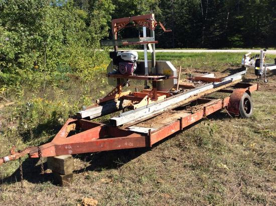 Lumberlite portable band saw mill w/ Honda 13 hp. gas engine; on trailer.