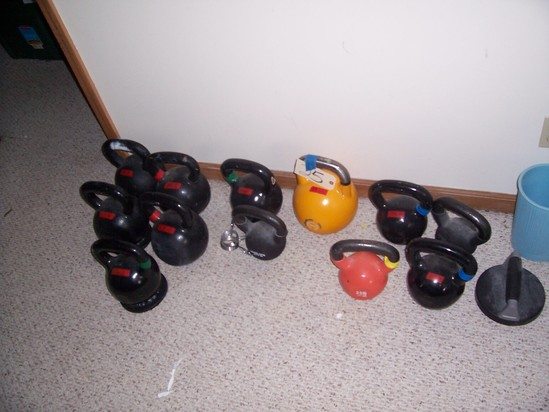 14 bell weights of various sizes