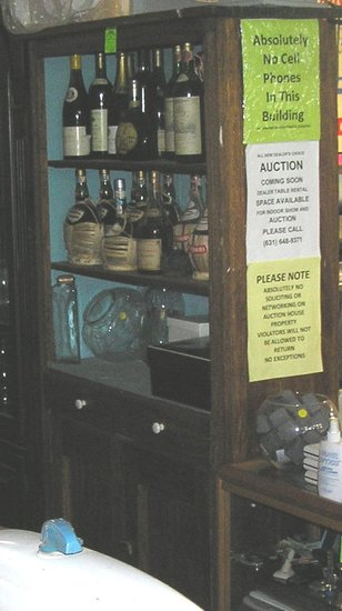 Antique oak cupboard with storage drawer