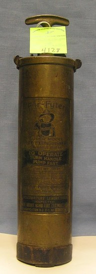 Antique solid brass fire fighter fire extinguisher
