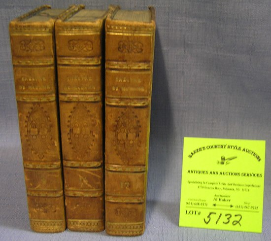 Group of three antique leather bound books