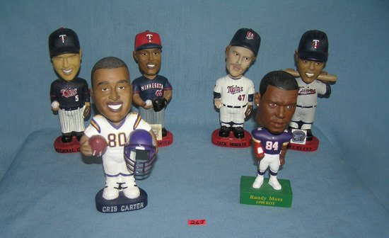 Minnesota Twins and Vikings bobble head figures