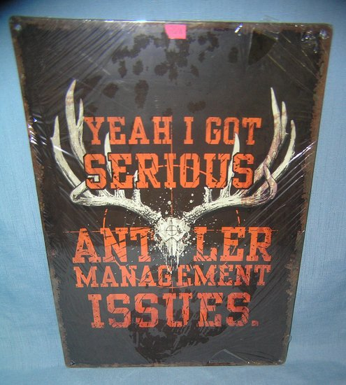All tin Antler management issues advertising sign