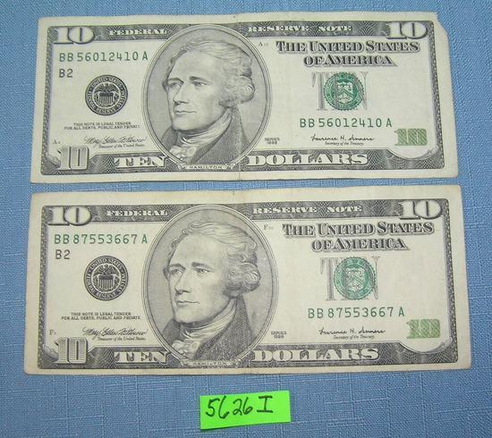 Pair of old style US ten dollar bills