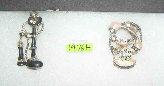 Pair of vintage telephone pins