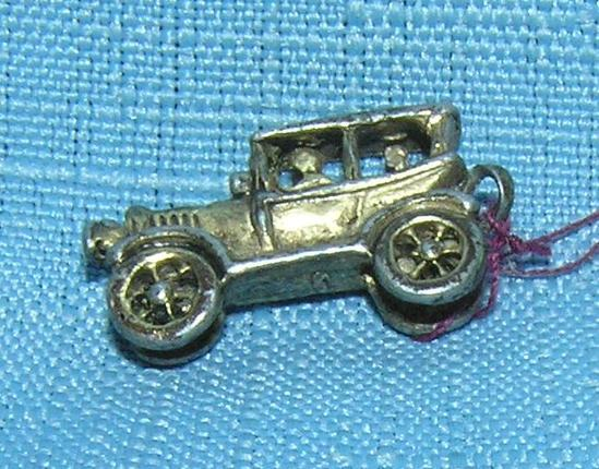 Early cast metal 2 passenger sedan miniature toy car