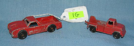 Pair of early cast metal midgit toy trucks