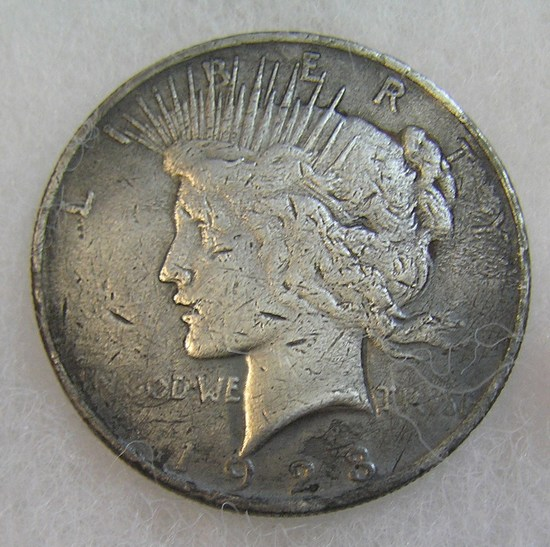 1923 Peace silver dollar in poor condition