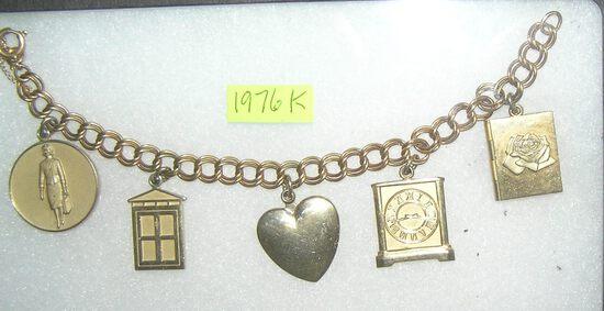 Avon sales rep award winning charm bracelet