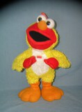 Figural and animated chicken dancing Elmo