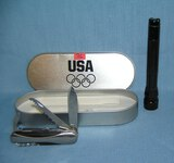 Maglite style flash light and US olympic pocket knife