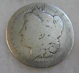 1880-O Morgan silver dollar in fair condition