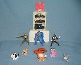 Collection of vintage toys featuring Batman and more