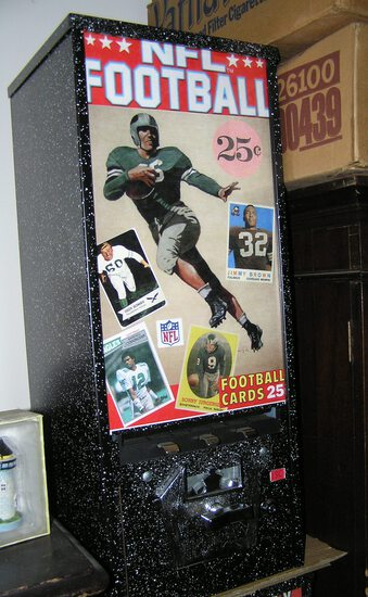 Football themed coin operated sports card vending machine