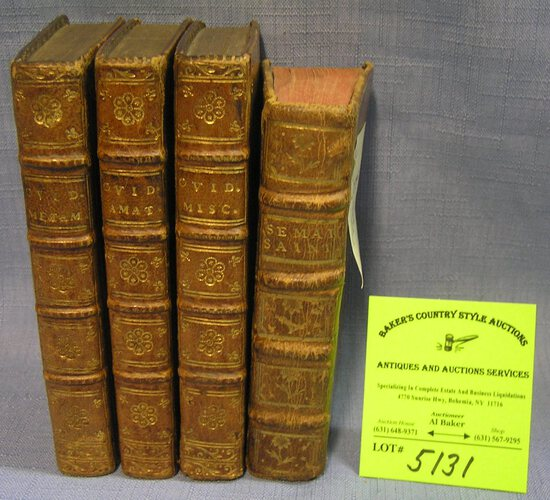 Group of four antique leather bound books