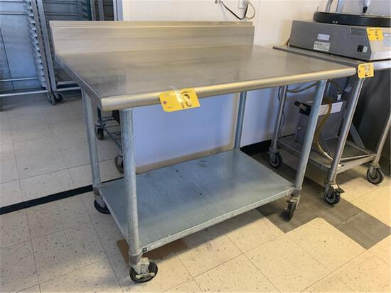 """DUKE 4' X 30"""" STAINLESS STEEL TABLE WITH 6"""" BACK SPLASH AND GALVANIZED SHELF, CASTERS"""